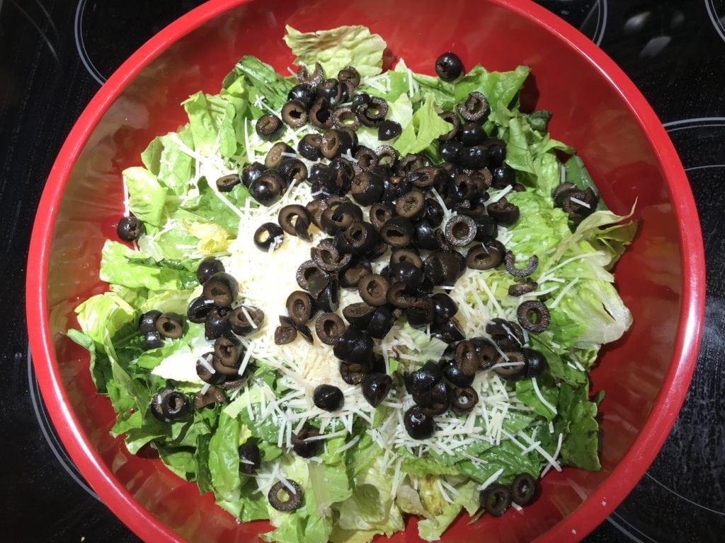Tossing a caesar salad