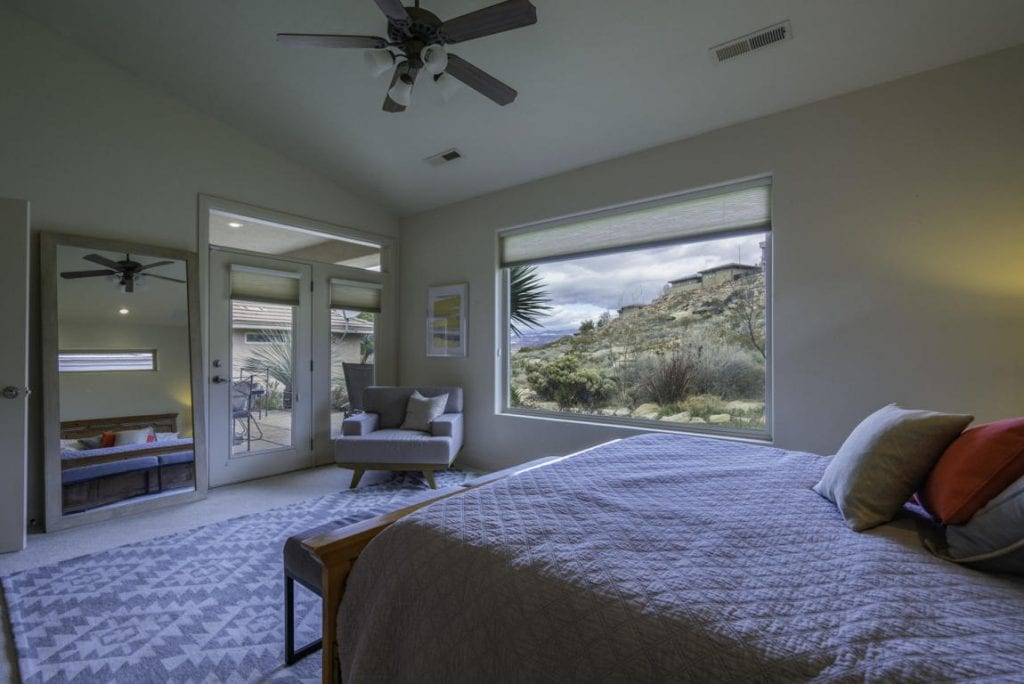 Sunny masterbedroom situated directly off the back patio