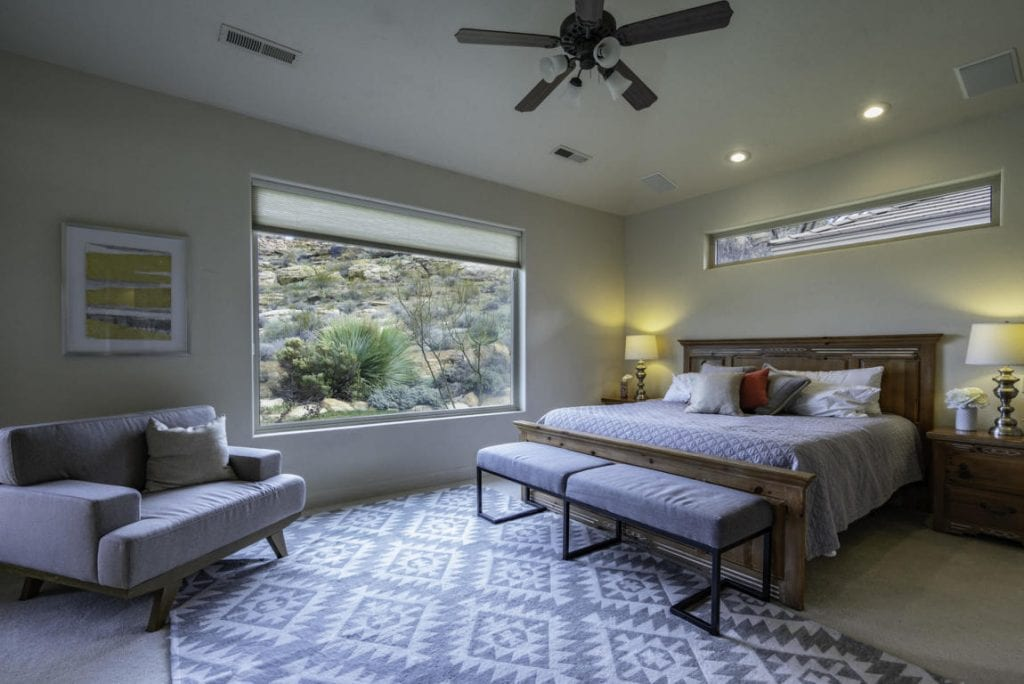 Sunny masterbedroom with picture windows and french doors