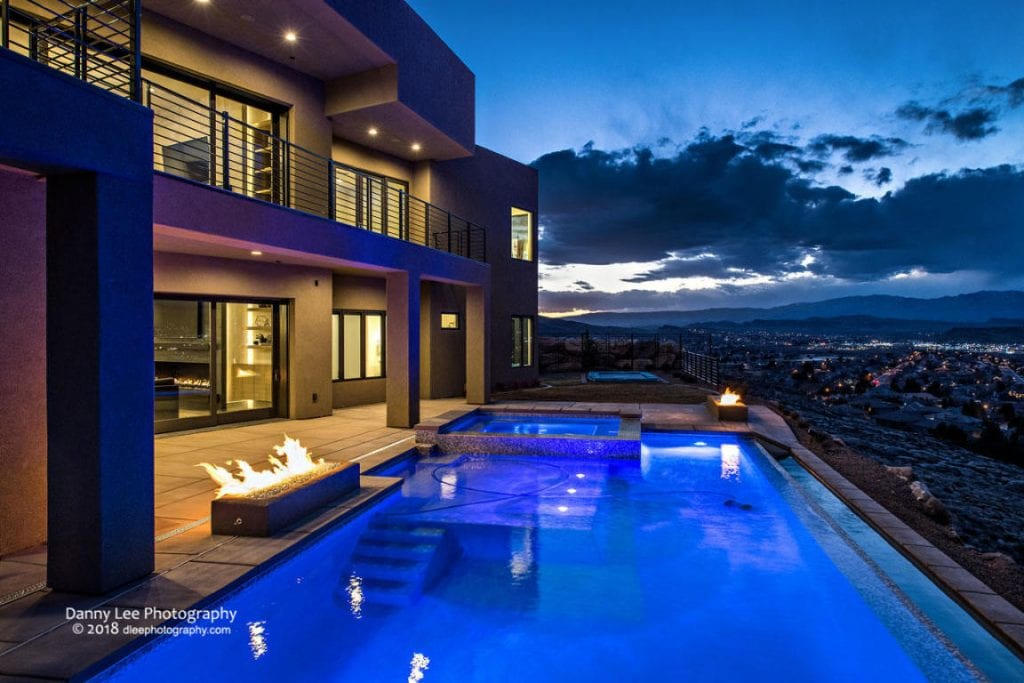 pool at night with firepit lit
