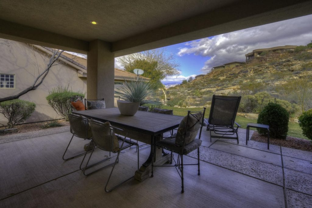 The rear covered patio is generous in size with beautiful views!